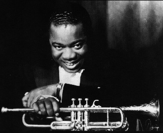 Photograph of a very young Louis Armstrong.