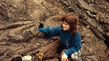 Photo of Megaera with her hand in a little lava tube.