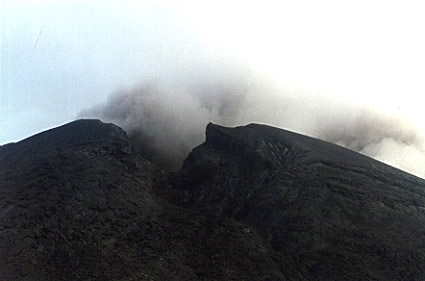 Photo by Brenna Lorenz of ash coming out of the vent at the summit of Mt. Pagan.