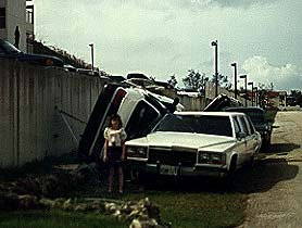 Photograph of cars overturned on top of other cars after Typhoon Omar.